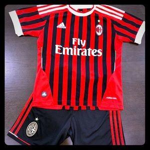 Adidas ACM boys soccer uniform.